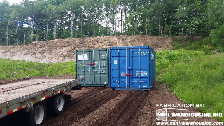 two blue storage containers at construction site