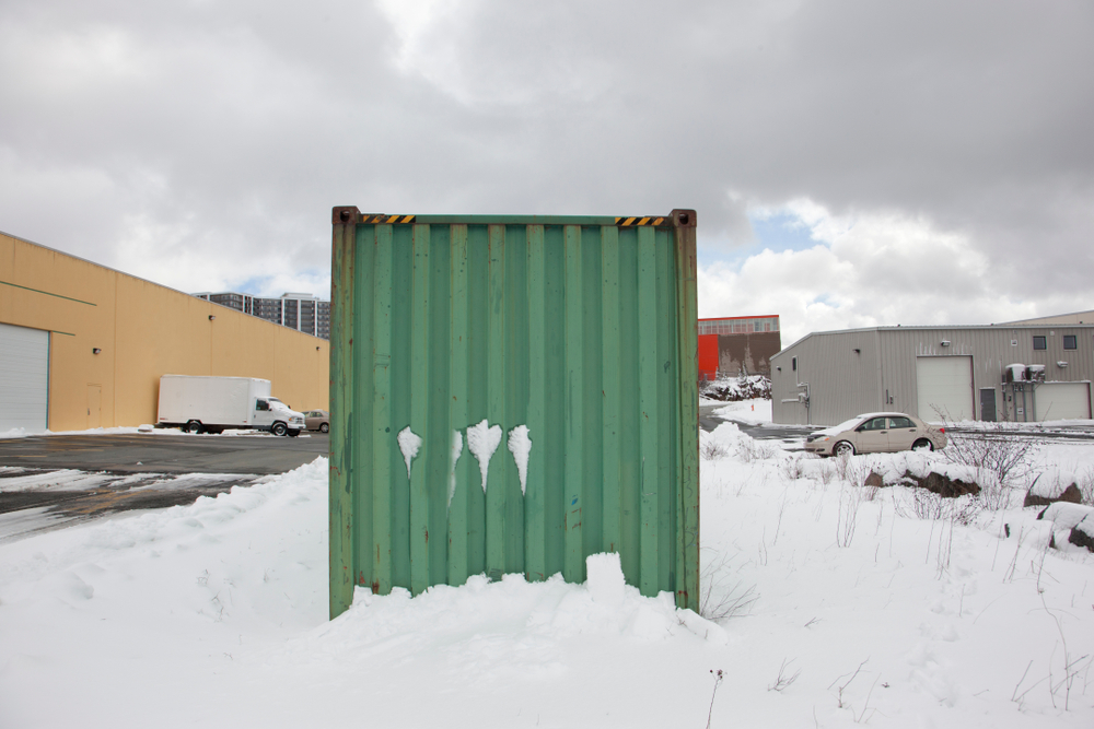 green storage container in snow